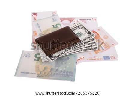 Close up detailed top view of heap of dollar and euro banknotes in and under a leather man wallet, isolated on white background. - stock photo