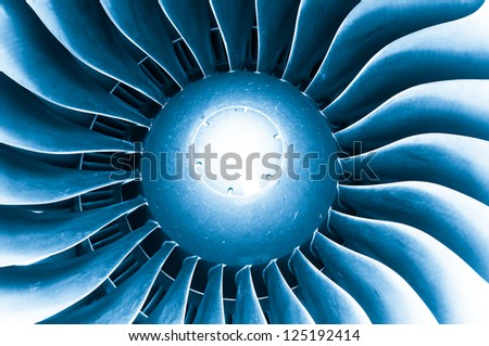 Close up detailed view of airplane engine turbine blades. - stock photo