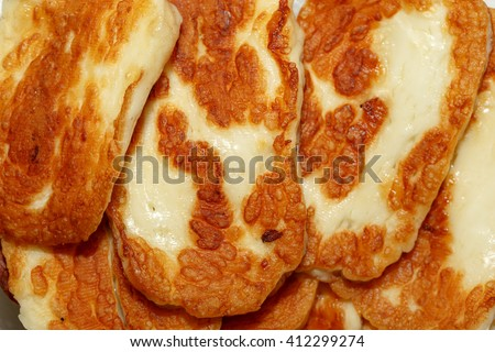 Close up detailed view of fried tasty halloumi cheese. - stock photo