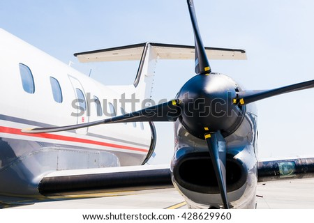 Close up details of a small private airplane aero jet engine standing on the ground before take off - stock photo