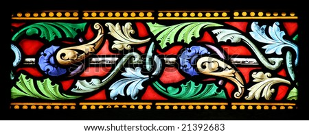 Close up details of a stained glass window in St.Sulpice church (Fougeres, France). - stock photo