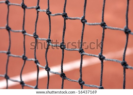 Close-up details of a tennis net-angle view (with selective focus).