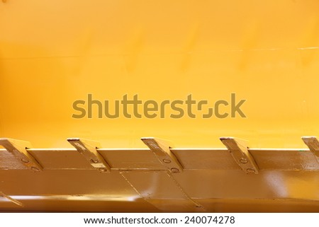 Close up digger excavator bucket bulldozer shovel yellow industrial background - stock photo