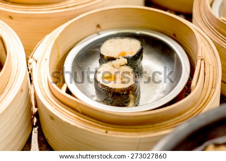 Close up dim sum in bamboo steamer, chinese cuisine - stock photo