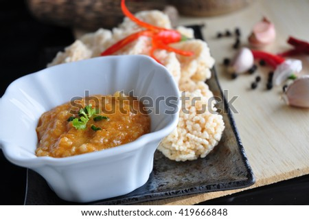 Close up dip sauce on rice cracker dish in Thai style - stock photo