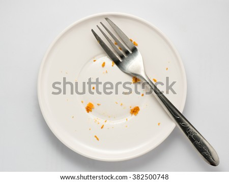 close up dirty dish and used fork isolated on white background - stock photo