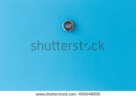 Close up door lens peephole on blue wooden texture - stock photo