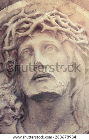 Close up dramatic statue of crucified Jesus Christ  (details) - stock photo