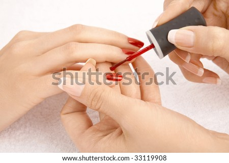 Close up - drawing of a red varnish on the nails, isolated - stock photo