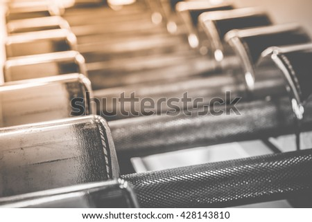 Close up Dumbbell in gym - vintage effect, Selective focus point on Dumbbell in fitness and gym room interior - Vintage Filter, Weight Training Equipment. - stock photo