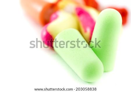 close up ear plug isolate on white background - stock photo