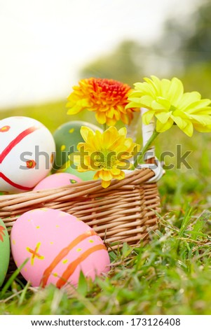 Close up easter painted eggs on the green meadow grass