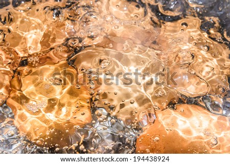 close up eggs in the boiling water - stock photo