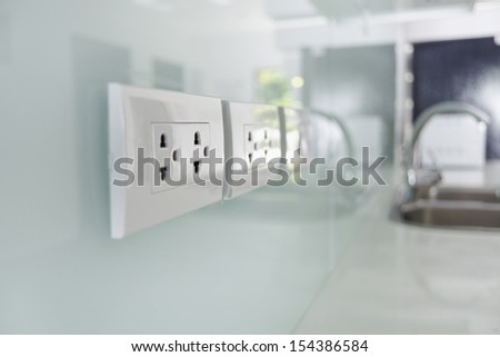 Close up electrical plug in the wall - stock photo