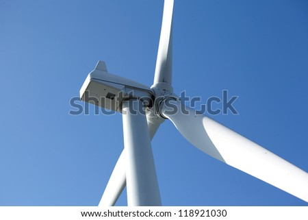 Close up electrical windmill screw against blue sky