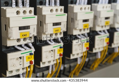 Close-up electrical wiring with fuses and contactors of machine control box. - stock photo