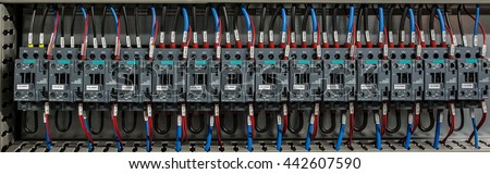 Close-up electrical wiring with fuses and contactors of machine control box - stock photo