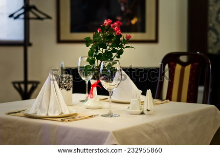 Close up Elegant Tabletop Setting Design for Two People Inside an Expensive Restaurant - stock photo