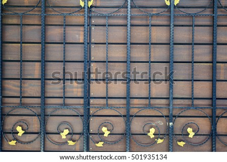 close up element of iron fence, curves and curls. background