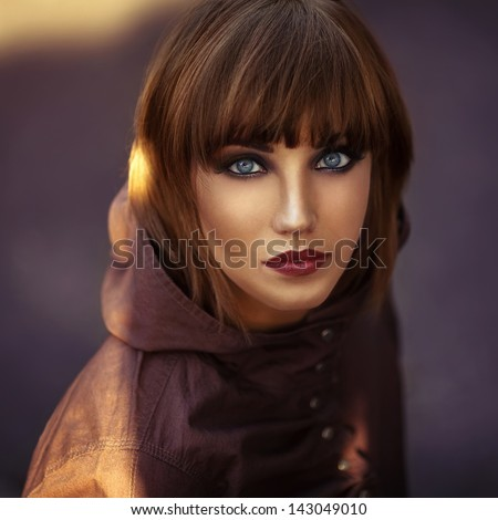 close up emotive portraite of young beautiful woman outside - stock photo