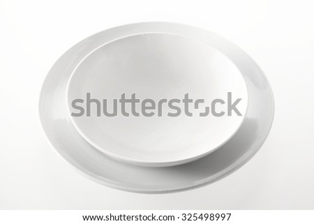 Close up Empty Porcelain Bowl on a Round Plate Isolated on a White Background.