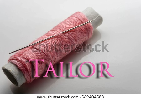 close up, equipment like sewing thread, needle and scissors.