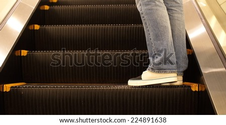 Close - up escalator in the modern building - stock photo