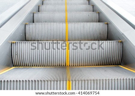 Close up Escalators stairway to transport people - stock photo