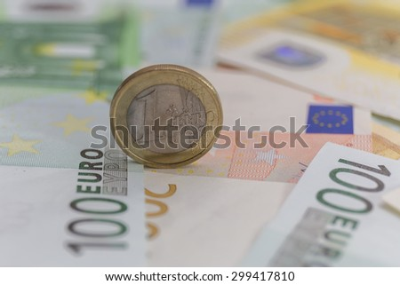close up euro euro coin on euro bank note background - stock photo