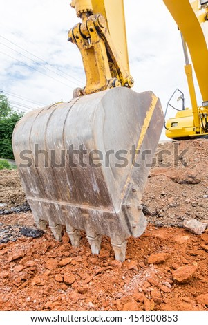 close up Excavators machine in construction site on sky background