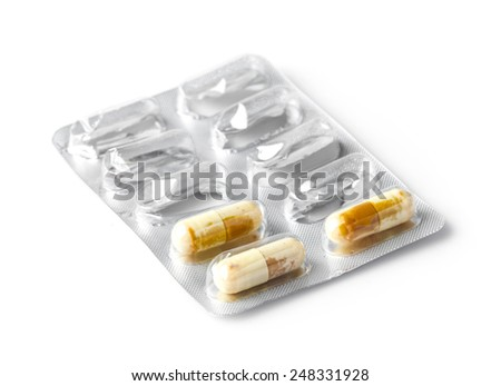 Close up expired medicine capsule isolated on white - stock photo