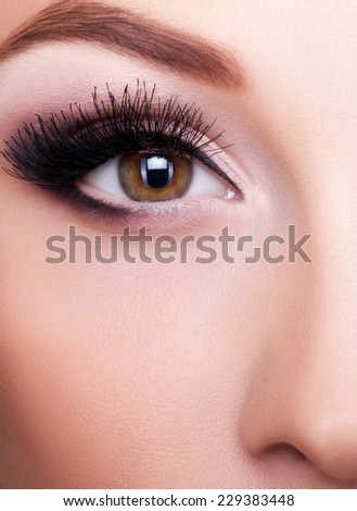 Close up eye with professional make up. Studio shooting and lighting - stock photo