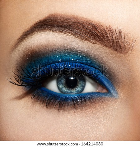 close up eyes with bright makeup. - stock photo