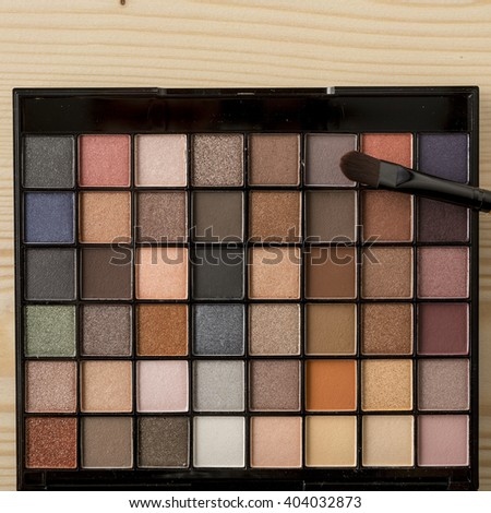 Close Up Eyeshadow Brush on Palette of Rose Nude Colors Eyeshadow. Professional make-up. Pastel Colours.