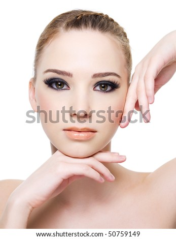 Close-up face of a beautiful young  woman with black eye make-up - isolated on white - stock photo