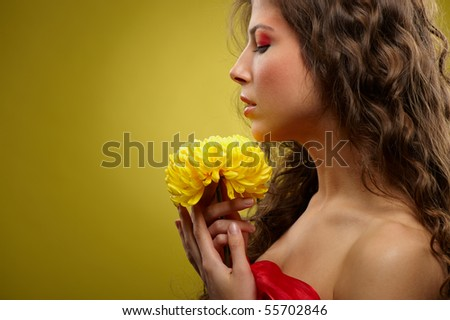 close-up face of a girl with a yellow flower
