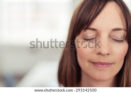 Close up Face of a Reflective Adult Woman with Eyes Closed, Emphasizing of Deep Thinking Facial Expression. - stock photo