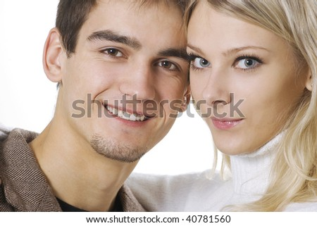Close-up face of attractive couple looking at camera