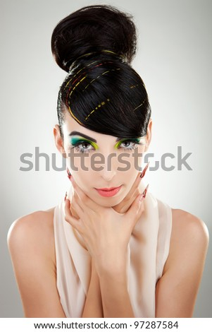 Close-up face of beautiful  brunette woman. Studio shot - stock photo