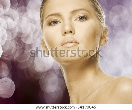 Close-up face of beautiful caucasian blonde woman with brown eyes. Studio shot - stock photo