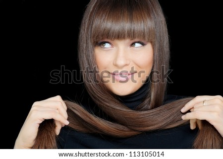 Close-up face of beautiful smiling woman with long hair - stock photo