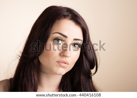 Close up face of beautiful young woman - stock photo