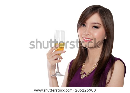 Close up face of glamorous Asian girl holding a glass of champagne and smiling to camera, isolated on white background - stock photo