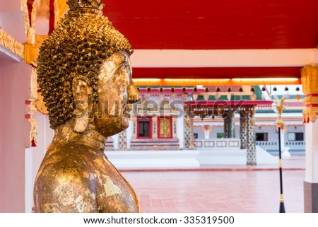Close up face of gold buddha with gold leaf sheets in Thailand. - stock photo
