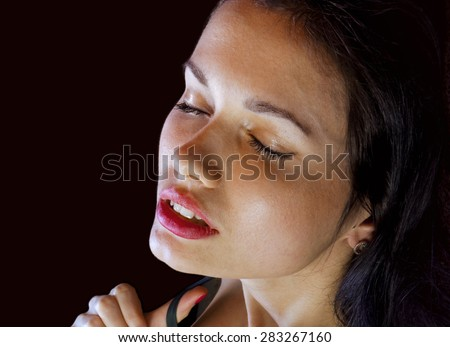 close up face of voluptuous girl derives pleasure - stock photo