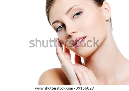Close-up face of young sexy  female with clean skin - over white background - stock photo