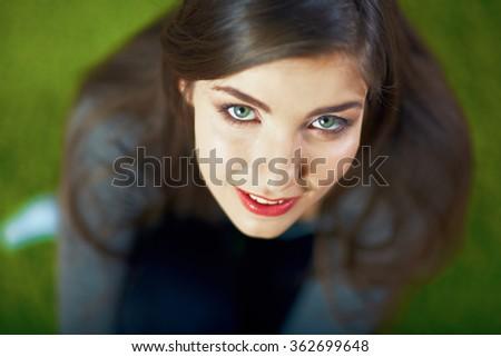 Close up face portrait of beautiful smiling teenager girl. Beautiful eyes. Long hair. - stock photo