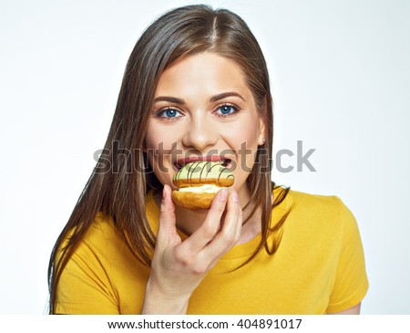 Close up face portrait of happy woman eating macaron French cake. Isolated portrait.