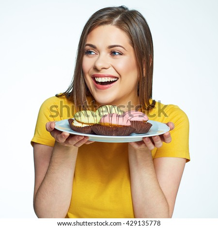 Close up face portrait of happy woman holding plate with macaron cake. French cake. Isolated portrait.