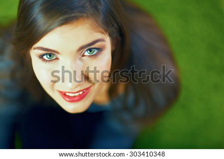 Close up face portrait of smiling girl. Beautiful eyes. Long hair. - stock photo